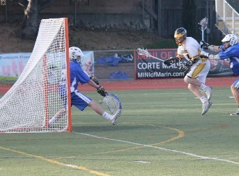 Goalie Adam Simon with a Kick Save vs Novato 3-26-13.jpg